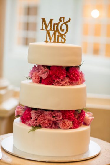 three tiered wedding cake by Gumnut Patisserie. Below is a selection of  their beautiful photos of the day and to view the entire wedding day  slideshow