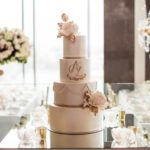 professional photo of bride at wedding cake sydney