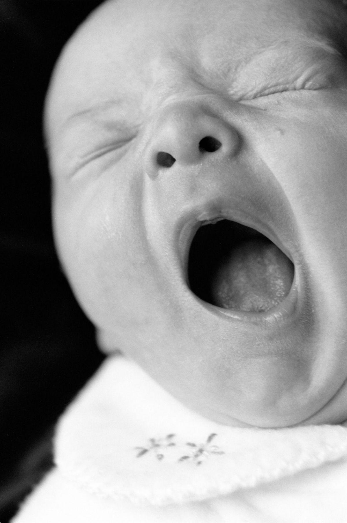 professional photo of baby yawning